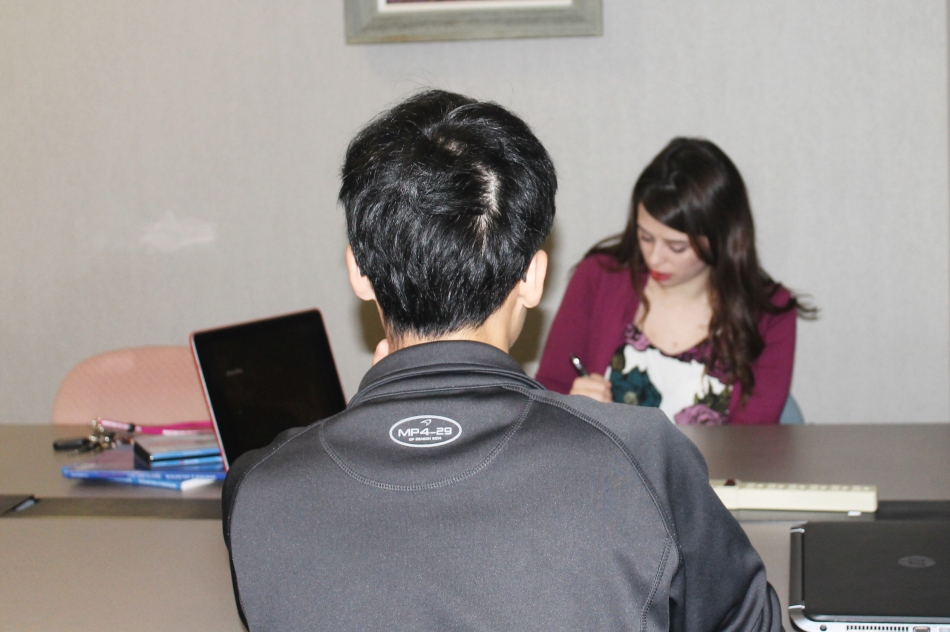 TESOL: Bronwen Fetters assists Mike Zhou, an international student learning English. (The student requested not to publish a photo of his face.) (Photo by Clarissa Hunter)