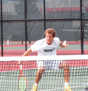 Senior Joseph Straznicky retreats after taking a volley at the net. Archive Photo