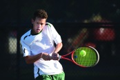 SINGLES MATCH: Ignacio Poncio returns a backhand to an awaiting conference opponent. (Photo provided by HU Athletics)