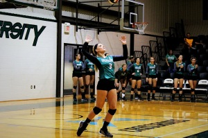 SERVICE POINT: Sophomore Emily Hubby serves the ball in Foresters' home match against Spring Arbor. (photo by Journey Masters)