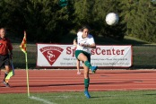 Senior Becca Grimes dishes out a corner kick in  the women's home match against Bethel Oct. 7 (photo by Quinton Worthy)