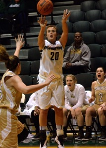 PULL UP: Amelia Recker, a senior forward, takes a jump shot in a 2014 game against Holy Cross. After the team's first five games this season, she is averaging 18.2 points per contest. (Photo provided by HU Athletics)