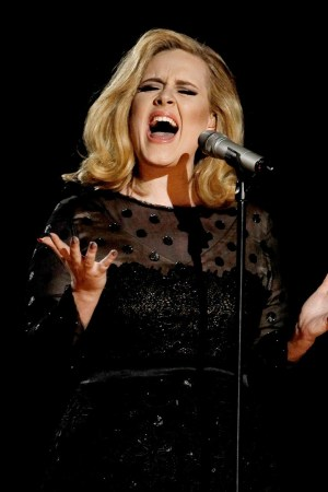 Adele performs her new song 'Hello' at sold out concert.