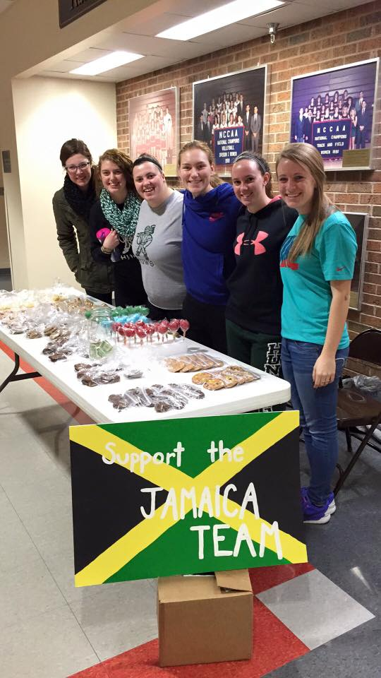 BAKING FOR A CAUSE: Team members from the Jamaica spring break team sell baked goods to raise funds for the trip. (Photo contributed)