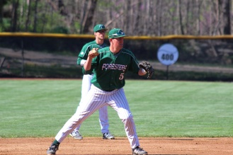 GROUND OUT: Shortstop Dylan Hendricks winds up to throw out Goshen batter at first. (photo by Journey Masters)