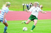 MIDFIELD: Senior Sarah Church passes up the field to a teammate. (Photo provided by HU Athletics)