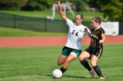 FULL EFFORT: Audra Klopfenstein passes to a team as she fends off a defender. (photo provided by HU Athletics)