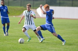 SENIOR LEADER: Isaac Wust, who leads HU in goals this season, passes a Bethel opponent. (photo provided by HU Athletics)