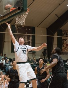 LAY IN: Trevor Lockwood, a sophomore center, scores a basket in Platt Arena. (photo provided by HU Athletics)