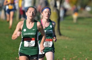 PULLING AHEAD: Aspen Dirr maintains her lead against a Cougar opponent. (photo provided by HU Athletics)